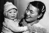 photo Crying Inuit baby being soothed by her mother